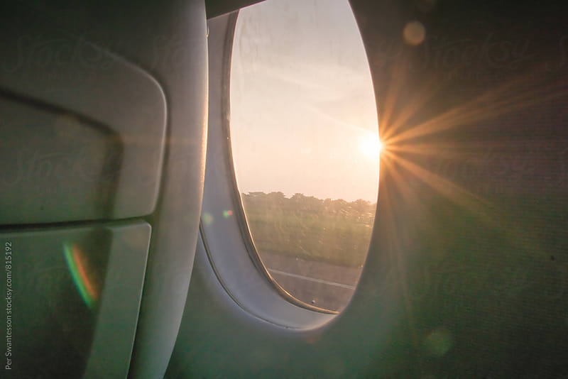 Looking out of airplane window at takeoff by Per Swantesson for Stocksy United