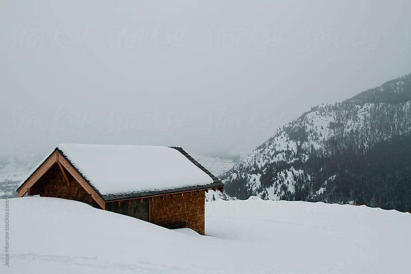 Cabin in the Snow by Jesse Morrow for Stocksy United