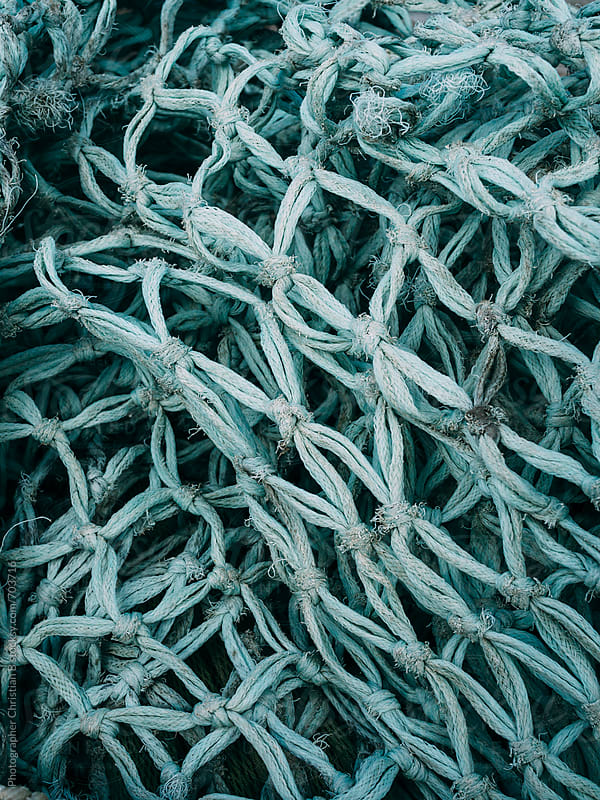 Old fishing net by Photographer Christian B for Stocksy United
