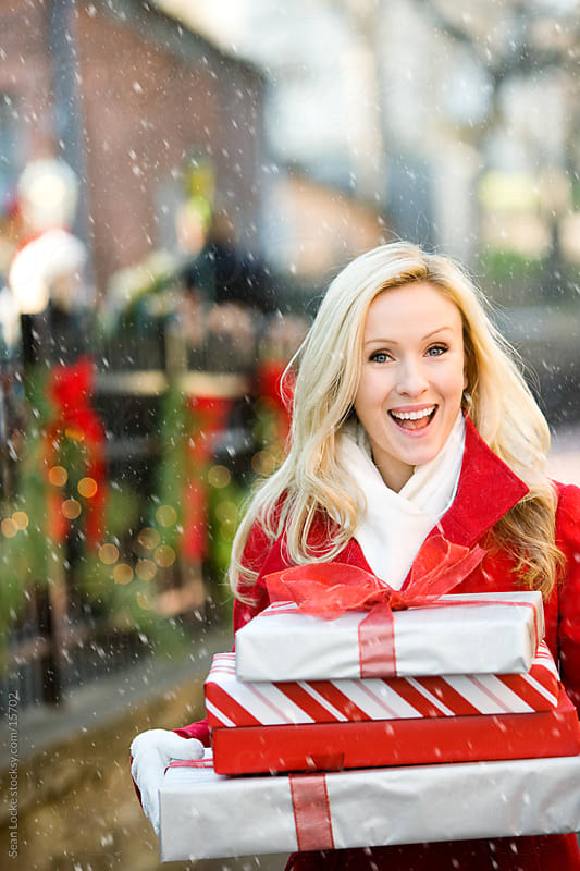 Christmas: Outside with Gifts on a Snowy Day by Sean Locke for Stocksy United