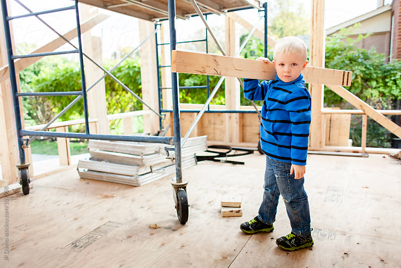 Little Boy Working as Framing Carpenter by JP Danko for Stocksy United