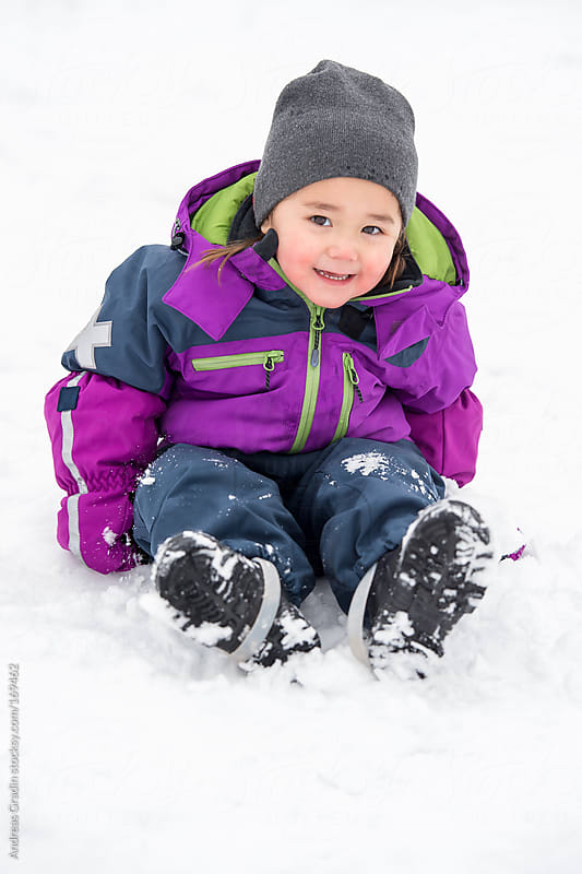 little girl having fun in the snow  by Andreas Gradin for Stocksy United