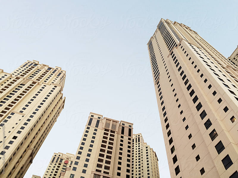 Skyscrapers in Dubai Next to Jumeira Beach by Nemanja Glumac for Stocksy United