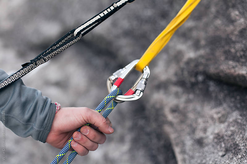Hand Feeds Rope Through Carabiners by Willie Dalton for Stocksy United
