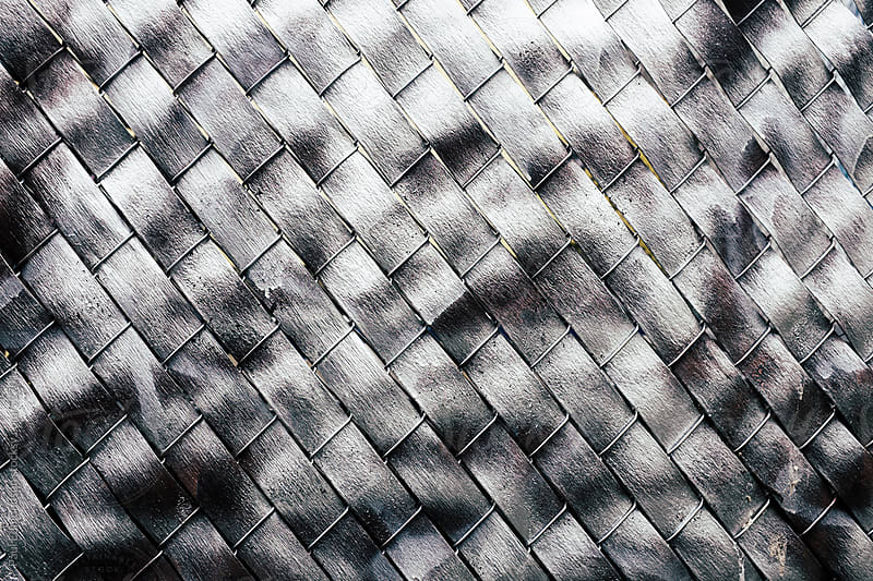Metallic silver paint covering chain-link fence by Paul Edmondson for Stocksy United