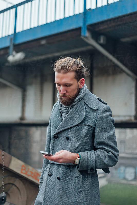Business man on the city street by Dimitrije Tanaskovic for Stocksy United