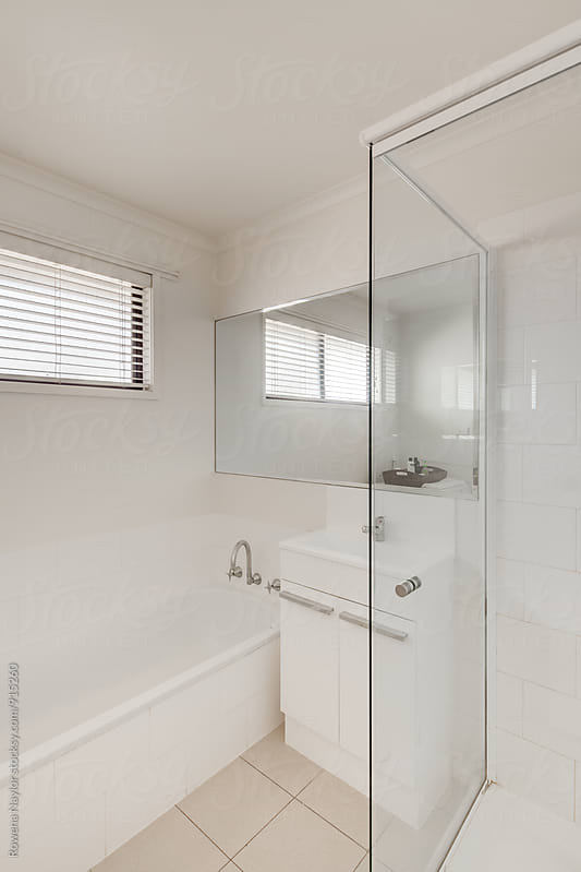Small bathroom by Rowena Naylor for Stocksy United