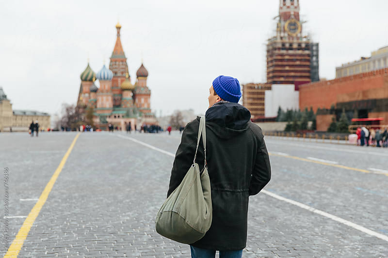 Tourist walking at Red Square, Moscow by Andrey Pavlov for Stocksy United