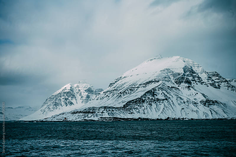 Coastal landscape of mountains of East Iceland in winter by Søren Egeberg Photography for Stocksy United