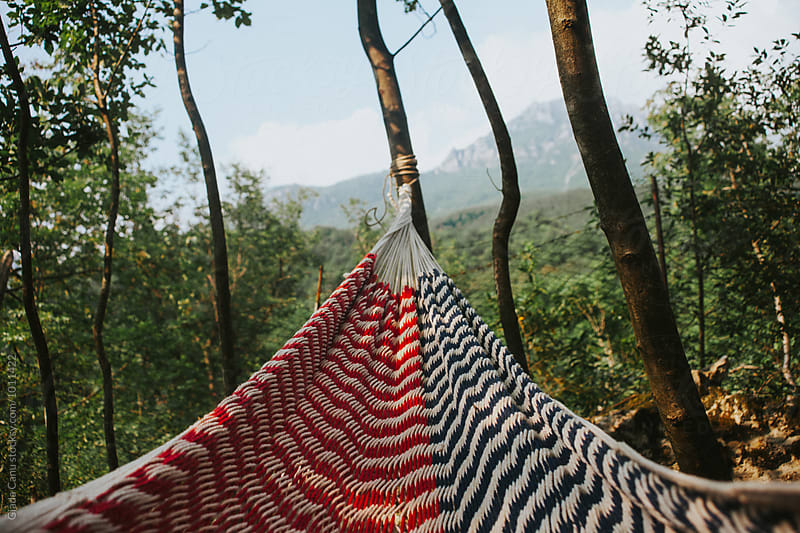 Relaxing on a hammock in nature by Giada Canu for Stocksy United