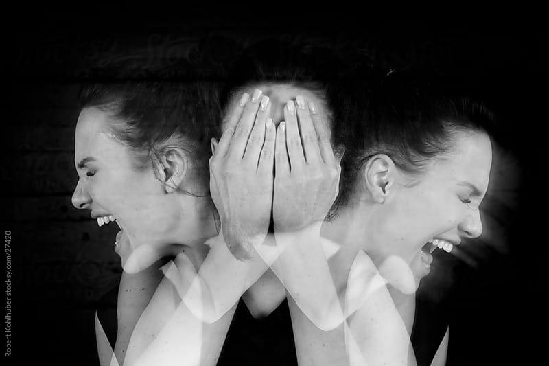 Screaming girl covering face- Mulitple exposures by Robert Kohlhuber for Stocksy United