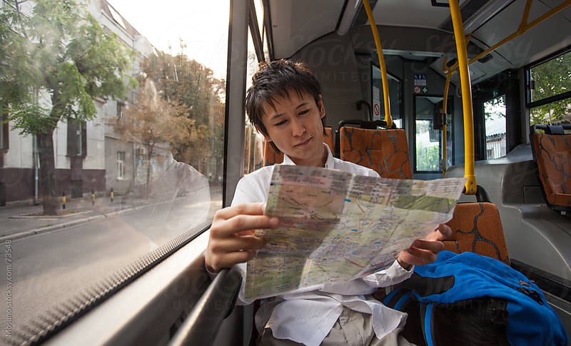 Japanese Tourist Sitting on a City Bus by Mosuno for Stocksy United