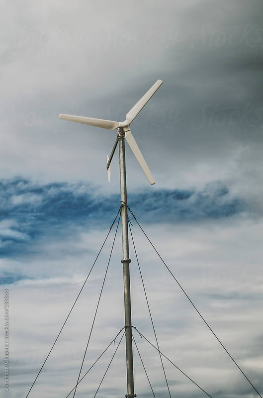 Wind Turbine against cloudy sky by Dominique Chapman for Stocksy United