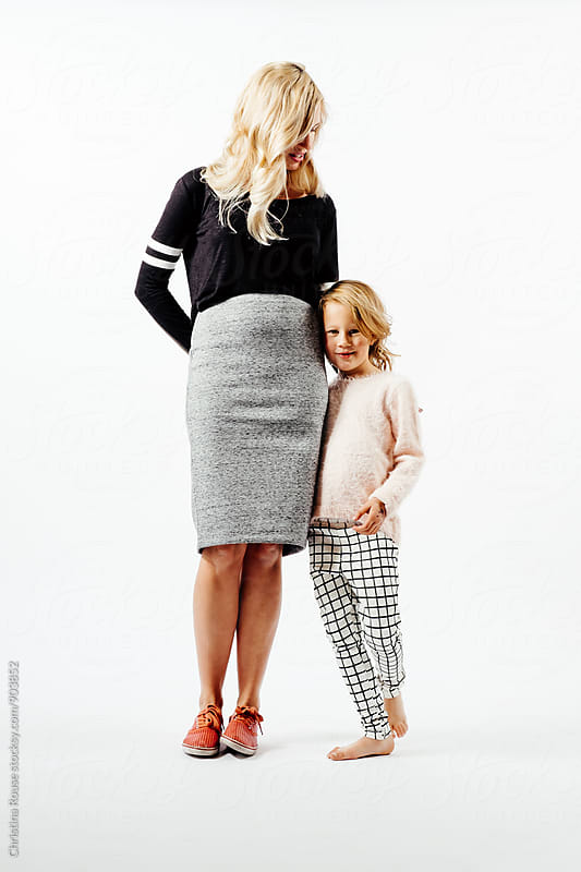 Mother and daughter stand together by Christina Rouse for Stocksy United