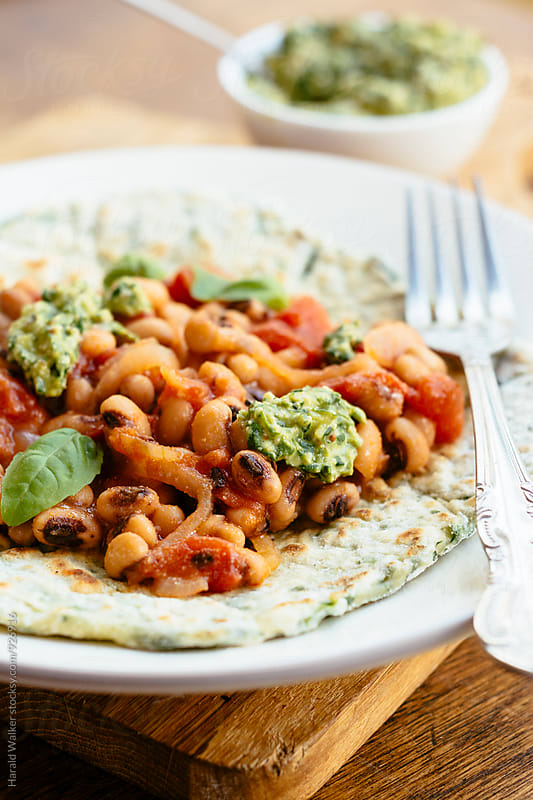 Spinach Flatbreads with Blackeyed-Pea Tomato Topping and Spinach Pesto by Harald Walker for Stocksy United