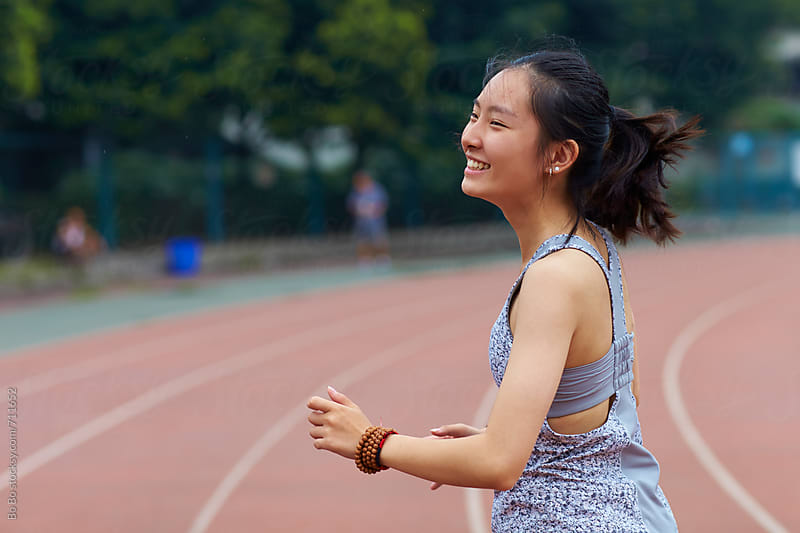 one happy young asian woman outdoor by cuiyan Liu for Stocksy United
