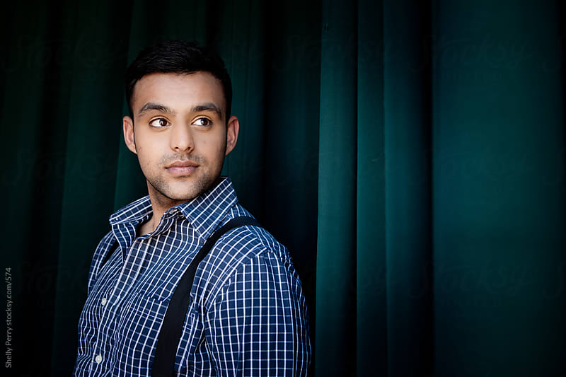 Portrait of a Young Man of Indian Decent  by Shelly Perry for Stocksy United