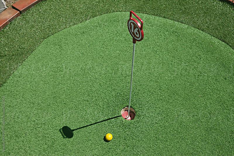 mini golf game by Natalie JEFFCOTT for Stocksy United