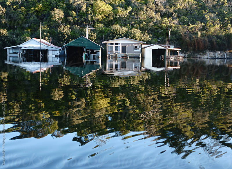 Four Cottages on River in Flood by Gary Radler Photography for Stocksy United