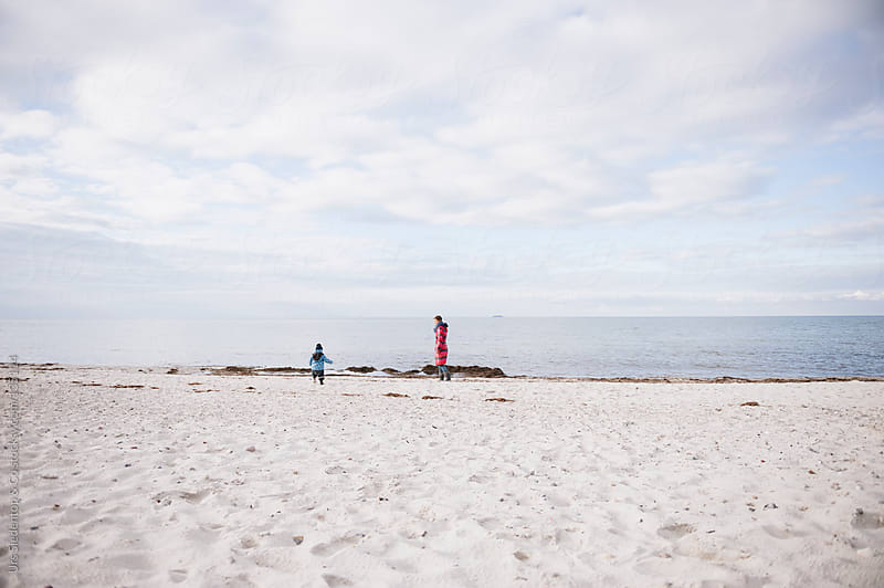 Mother and son at the beach by Urs Siedentop & Co for Stocksy United