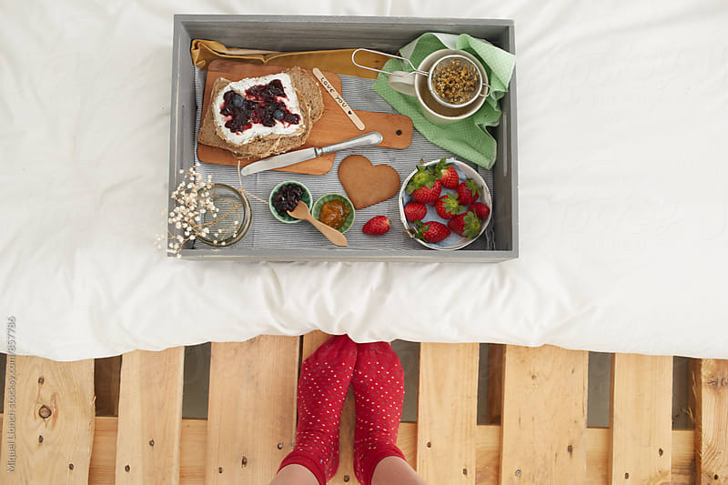 Excellent breakfast served in a wooden box as a tray by Miquel Llonch for Stocksy United