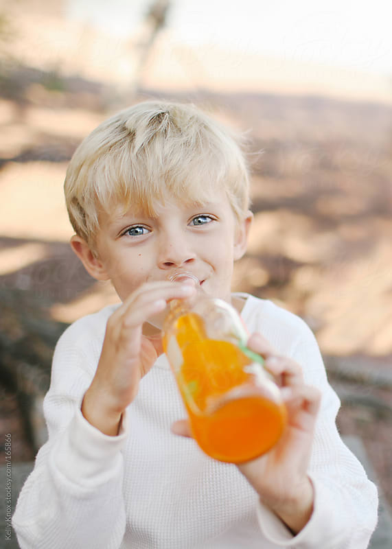 boy drinking a soda by Kelly Knox for Stocksy United
