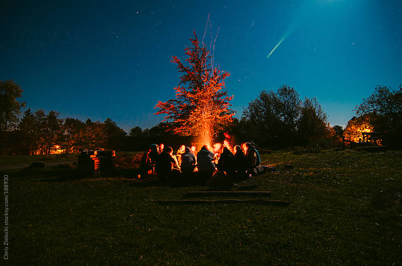 Campfire under the stars by Chris Zielecki for Stocksy United