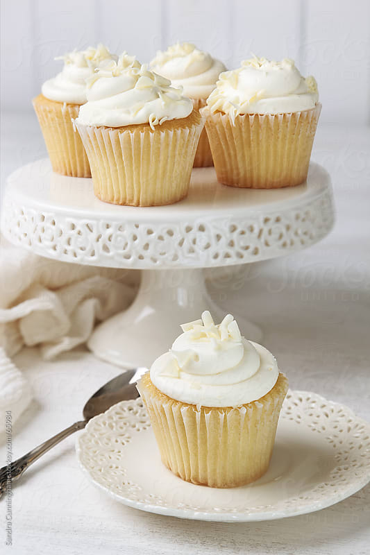 Cupcakes decorated with icing and white chocolate by Sandra Cunningham for Stocksy United