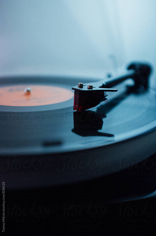 Gramophone playing gramophone vinyl record by Tomas Mikula for Stocksy United