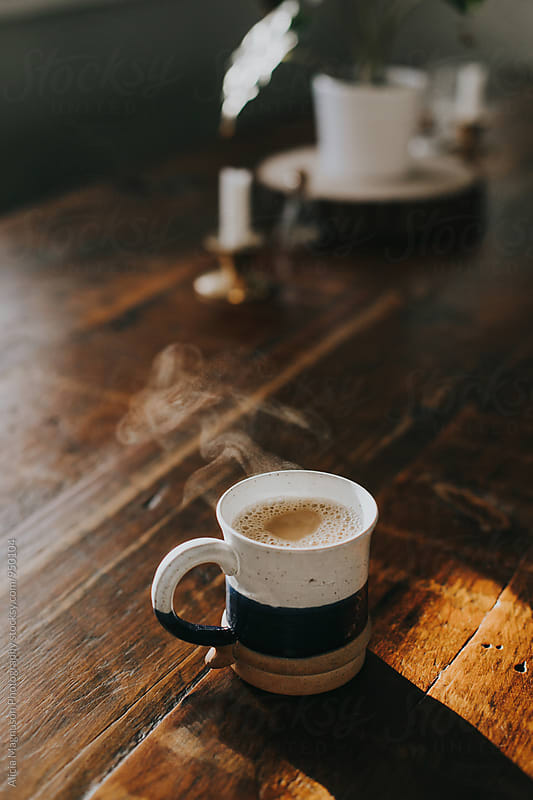 Coffee Cup on Table by Alicia Magnuson Photography for Stocksy United