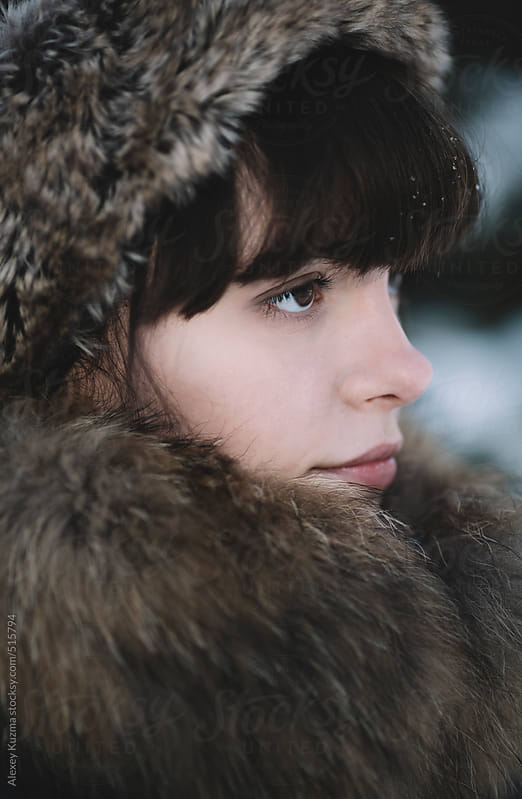 winter close-up of the young woman . by Alexey Kuzma for Stocksy United