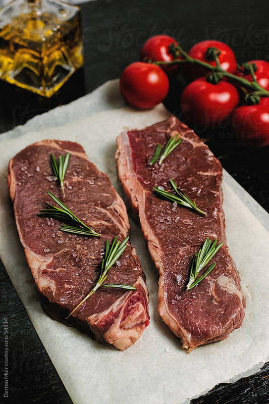 Scottish beef steaks on a table. by Darren Muir for Stocksy United