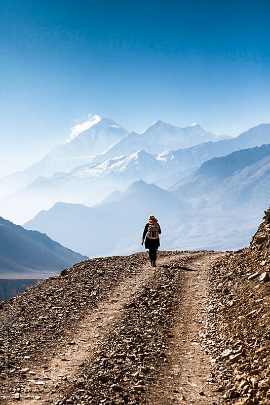 Woman walking in the himalayas. by Shikhar Bhattarai for Stocksy United