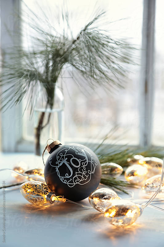 Black christmas ball with golden lights by Sandra Cunningham for Stocksy United