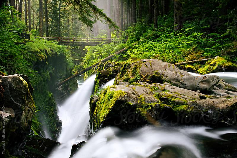 Rocks break waterfall into three falls by Thomas Shull for Stocksy United