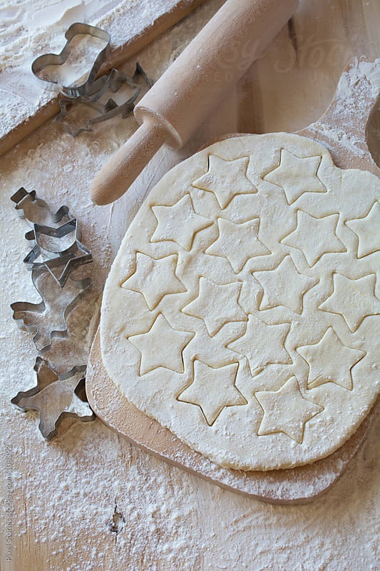 Preparing Christmas cookies by Pixel Stories for Stocksy United