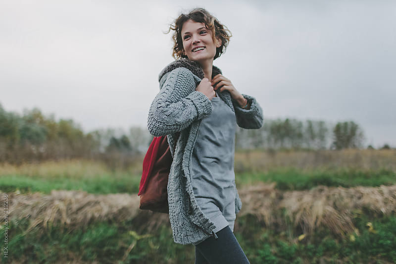 Smiling Woman with Pack in Nature by HEX. for Stocksy United