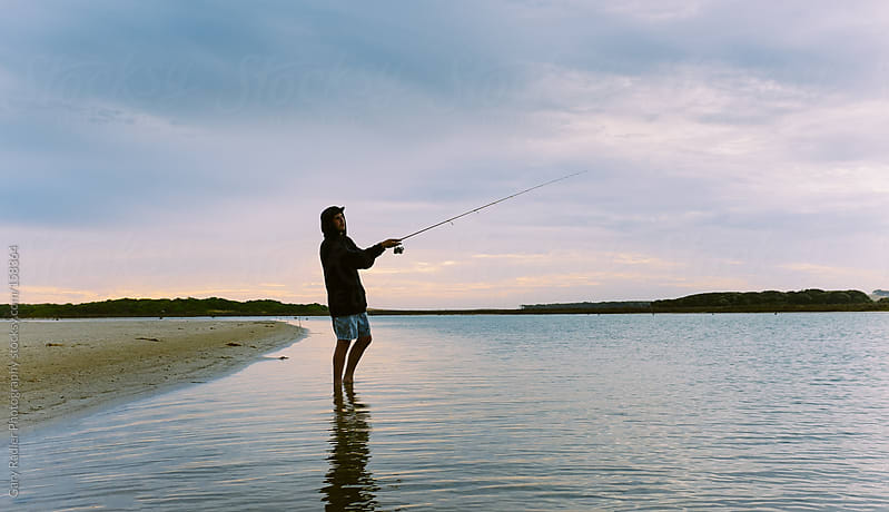 Man fishing in a Estuary by Gary Radler Photography for Stocksy United