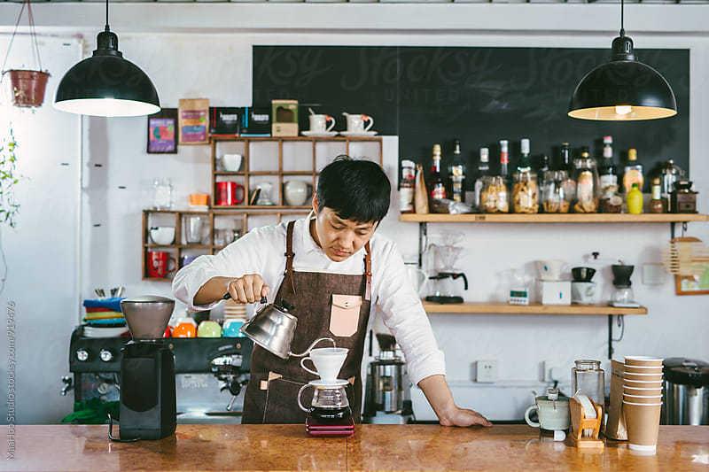 Young coffee shop owner making coffee by MaaHoo Studio for Stocksy United