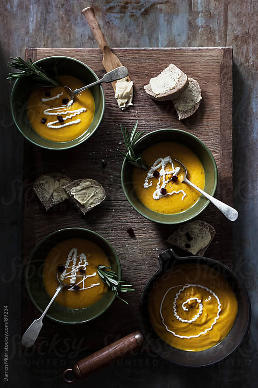 Pumpkin and rosemary soup by Darren Muir for Stocksy United