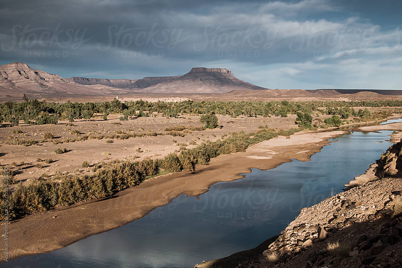 River going through Desert Landscape in Morocco by Andreas Wonisch for Stocksy United