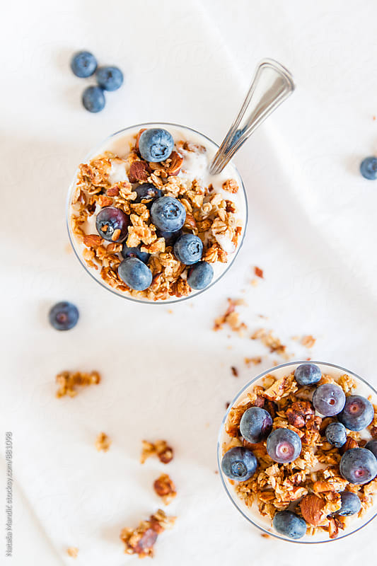 Yogurt with granola and blueberries by Nataša Mandić for Stocksy United
