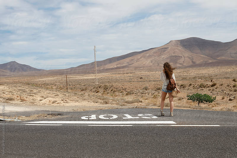 girl on the road by Rene de Haan for Stocksy United