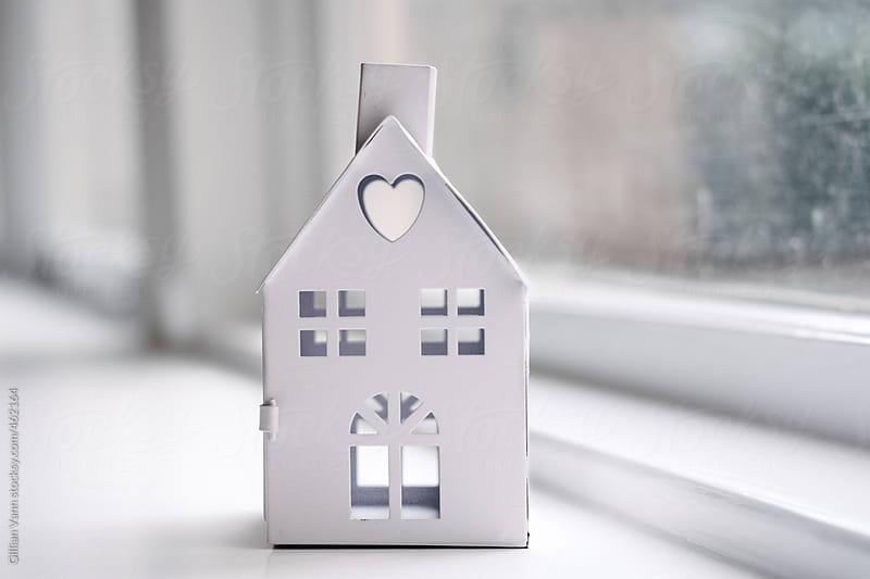 mini house on windowsill by Gillian Vann for Stocksy United