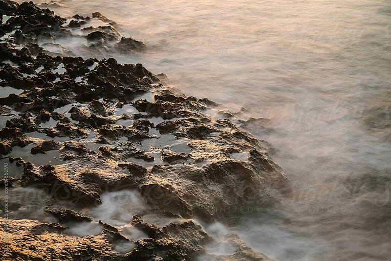 Long Exposure Shot of Sea Water Moving on a Rock Coast  by VICTOR TORRES for Stocksy United