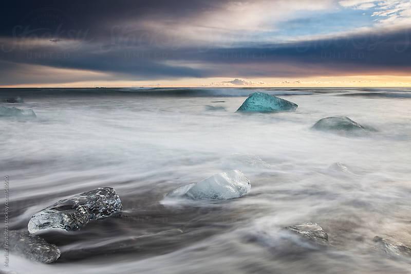 Iceberg at Jokulsarlon black sand beach by Marilar Irastorza for Stocksy United