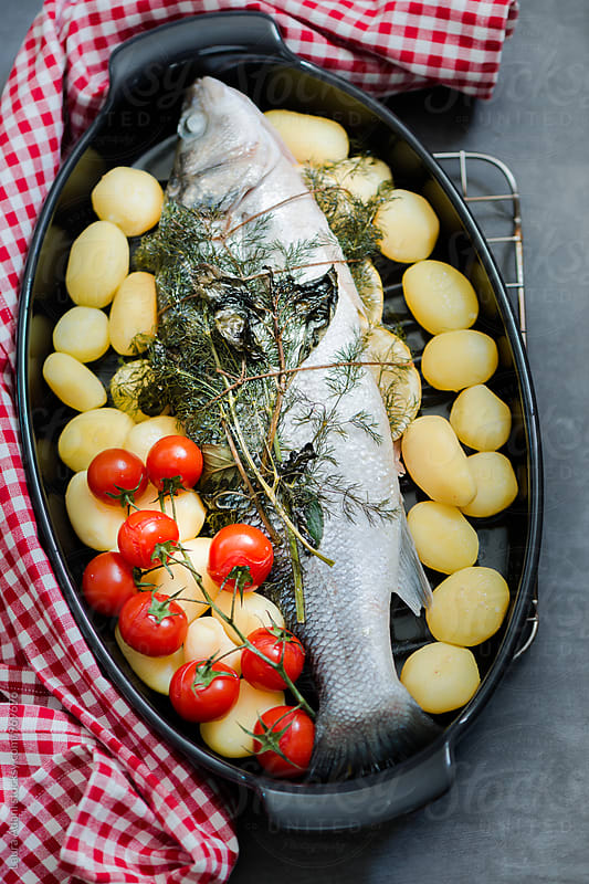 Baked Sea bass   by Laura Adani for Stocksy United