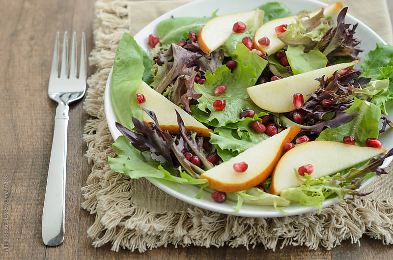 Mixed Greens With Pear and Pomegranate by Julie Rideout for Stocksy United