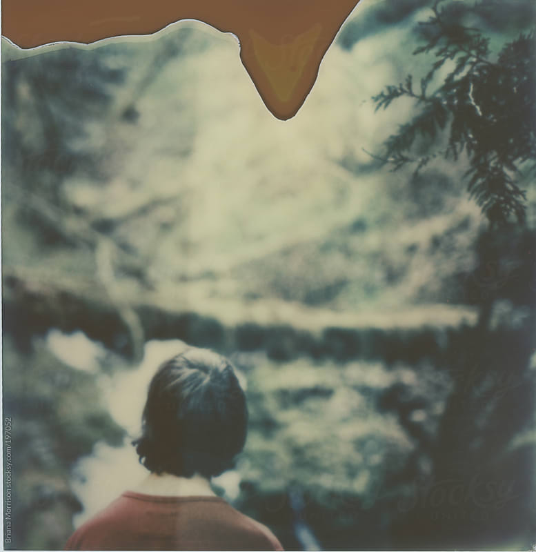 Polaroid of Boy in Green Forest by Briana Morrison for Stocksy United