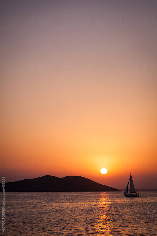 Sailboat in La Manga del Mar Menor, Mediterranean Sea by VICTOR TORRES for Stocksy United